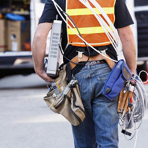 lineman carrying equipment